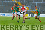 Shane McSweeney Kilcummin goes past Colin McGillicuddy and Fiachra Clifford Mid Kerry  during their SFC clash in Fitzgerald Stadium on Saturday