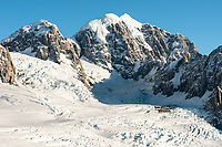 Second highest peak of Southern Alps, Mount Tasman 3497m and deep crevasses of upper part of Fox Glacier, Westland Tai Poutini National Park, West Coast, UNESCO World Heritage, New Zealand, NZ