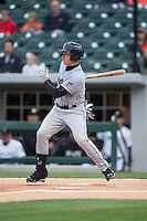 Slade Heathcott (12) of the Scranton\Wilkes-Barre RailRiders follows through on his swing against the Charlotte Knights at BB&T BallPark on May 1, 2015 in Charlotte, North Carolina.  The RailRiders defeated the Knights 5-4.  (Brian Westerholt/Four Seam Images)