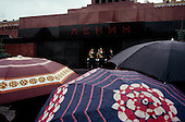 """Moscow, Russia<br /> Soviet Union<br /> August 30, 1991<br /> <br /> The guards at Lenin's Mausoleum in Red Square goose-stepping off during their shift change. This spectacle stopped on October 7, 1993.<br /> <br /> In December 1991, food shortages in central Russia had prompted food rationing in the Moscow area for the first time since World War II. Amid steady collapse, Soviet President Gorbachev and his government continued to oppose rapid market reforms like Yavlinsky's """"500 Days"""" program. To break Gorbachev's opposition, Yeltsin decided to disband the USSR in accordance with the Treaty of the Union of 1922 and thereby remove Gorbachev and the Soviet government from power. The step was also enthusiastically supported by the governments of Ukraine and Belarus, which were parties of the Treaty of 1922 along with Russia.<br /> <br /> On December 21, 1991, representatives of all member republics except Georgia signed the Alma-Ata Protocol, in which they confirmed the dissolution of the Union. That same day, all former-Soviet republics agreed to join the CIS, with the exception of the three Baltic States."""