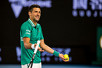 12th February 2021, Melbourne, Victoria, Australia; Novak Djokovic of Serbia shows his frustration to the people in his players box about the behaviour of the crowd during round 3 of the 2021 Australian Open on February 12 2020, at Melbourne Park in Melbourne, Australia.