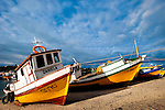 Fishing Boats shored at low tide at Calbuco, Los Lagos Region, Chile in South America