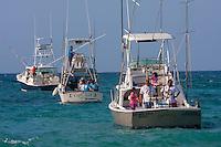 Passengers Getting Ready for a Day of Sport Fishing.  Playa del Carmen, Riviera Maya, Yucatan, Mexico.