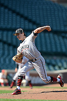 Pitcher Carson Sands (11) of Florida Christian School in Tallahassee, Florida delivers a pitch during the Under Armour All-American Game on August 24, 2013 at Wrigley Field in Chicago, Illinois.  (Mike Janes/Four Seam Images)