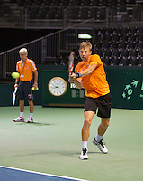 Switserland, Genève, September 16, 2015, Tennis,   Davis Cup, Switserland-Netherlands, Practise Dutch team,Tallon Griekspoor  hits the ball under the watchful eye of coach Martin Bohm<br /> Photo: Tennisimages/Henk Koster