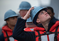 130423-N-DR144-018 Pacific Ocean (April 23, 2013)- Seaman Justin Lafarlette listens to orders while participating in an underway replenishment detail aboard Amphibious Transport Dock Ship USS Anchorage (LPD 23) as the ship takes on fuel from fleet replenishment oiler USNS Henry J. Kaiser (T-AO 187). Anchorage is currently en route to its namesake city of Anchorage, Alaska for its commissioning ceremony May 4. (U.S. Navy photo by Mass Communication Specialist 1st Class James R. Evans / RELEASED)