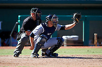Peoria Javelinas catcher Mike Zunino #36, of the Seattle Mariners organization, and umpire Nick Bailey during an Arizona Fall League game against the Mesa Solar Sox at HoHoKam Park on October 15, 2012 in Mesa, Arizona.  Peoria defeated Mesa 9-2.  (Mike Janes/Four Seam Images)