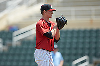 Kannapolis Intimidators starting pitcher Zach Lewis (28) looks to his catcher for the sign against the Greensboro Grasshoppers at Kannapolis Intimidators Stadium on August 5, 2018 in Kannapolis, North Carolina. The Grasshoppers defeated the Intimidators 2-1 in game one of a double-header.  (Brian Westerholt/Four Seam Images)