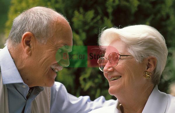 Retired couple relaxing in garden