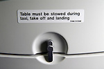 Tables must be stowed away during taxi take off and landing. Close up sign British Airways on the back of a passenger seat  2016, 2010s,