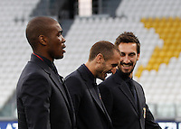 From left, Italy's Angelo Ogbonna, Leonardo Bonucci and Davide Astori inspect the pitch of the Juventus Stadium, ahead of the FIFA World Cup 2018 qualification match against Spain, in Turin, 5 October 2016.<br />