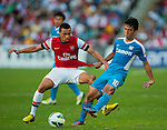 Andre Santos of Arsenal FC and Lam Ka Wai of Kitchee FC in action during the pre-season Asian Tour friendly match at the Hong Kong Stadium on July 29, 2012. Photo by Victor Fraile / The Power of Sport Images