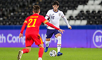 SWANSEA, WALES - NOVEMBER 12: Johnny #16 of the United States moves forward with the ball during a game between Wales and USMNT at Liberty Stadium on November 12, 2020 in Swansea, Wales.