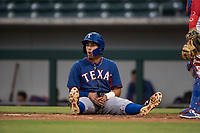 AZL Rangers third baseman Jonathan Ornelas (10) sits in disbelief after being misruled out during an Arizona League game against the AZL Cubs 2 at Sloan Park on July 7, 2018 in Mesa, Arizona. AZL Rangers defeated AZL Cubs 2 11-2. (Zachary Lucy/Four Seam Images)