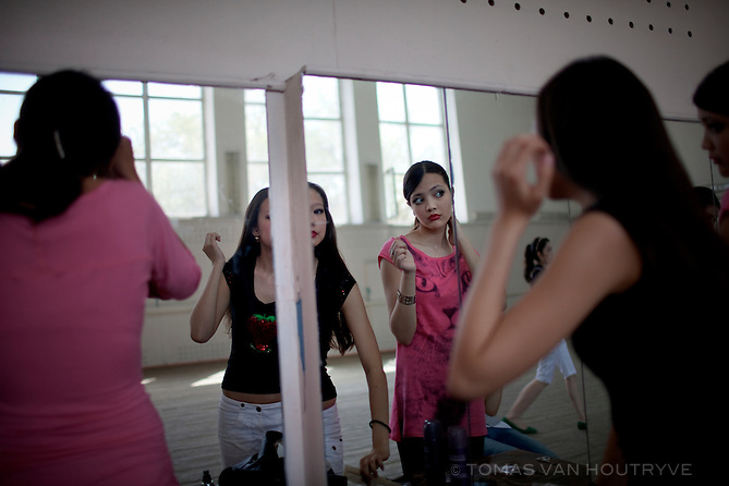 Girls at a modelling school groom themselves in a mirror in Elista, Republic of Kalmykia, Russian Federation on May 10, 2010.
