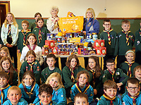 Sarah Pudsey, Aldi Store Manager (CENTRE IN BLUE), Pat Parkhurst, scout leader (CENTRE IN BEIGE) with children from the scout group