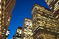 THIS IMAGE IS AVAILABLE EXCLUSIVELY FROM GETTY IMAGES<br /> <br /> Please search for image # sb10066168a-001 on www.gettyimages.com<br /> <br /> View of Illuminated Office Buildings on 6th Avenue at Dusk (Soft Focus), Midtown Manhattan, New York City, New York State, USA