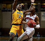 SIOUX FALLS, SD - MARCH 8: Stanley Umude #0 of the South Dakota Coyotes drives on Tyree Eady #3 of the North Dakota State Bison during the Summit League Basketball Tournament at the Sanford Pentagon in Sioux Falls, SD. (Photo by Dave Eggen/Inertia)