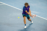 12th February 2021, Melbourne, Victoria, Australia; Taylor Fritz of the United States of America returns the ball during round 3 of the 2021 Australian Open on February 12 2020, at Melbourne Park in Melbourne, Australia.