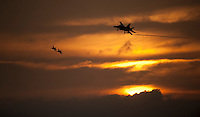 F/A-18's approach to recover aboard USS Carl Vinson at sunset.
