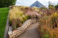 Path through Ornamental Grasses Garden with Science Pyramid in Denver Botanic Garden