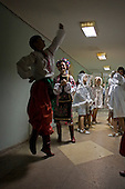 Ternopol, Ukraine.May 28, 2005 ..Dancers warm up backstage before performing to an audience that is waiting for Ukraine President Victor Yushchenko who arrives 5 hours late. He was to make his first visit back of his University (Ternopol Economic University)...