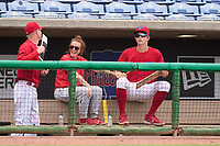 Clearwater Threshers pitcher Mick Abel (25) joke with athletic trainer Holly Hansing after a baseball bat flew into the dugout when the batter lost grip during a game against the Daytona Tortugas on June 25, 2021 at BayCare Ballpark in Clearwater, Florida.  (Mike Janes/Four Seam Images)