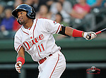Second baseman Wendell Rijo (11) of the Greenville Drive watches his second-inning home run sail over the left field wall in a game against the Asheville Tourists on Monday, April 21, 2014, at Fluor Field at the West End in Greenville, South Carolina. Rijo is the No. 18 prospect of the Boston Red Sox, according to Baseball America. Greenville won, 8-3. (Tom Priddy/Four Seam Images) (Tom Priddy/Four Seam Images)