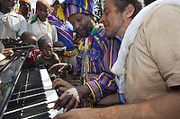 """Ethiopia. Southern Nations, Nationalities, and Peoples' Region. Karat village. Konso tribe. Marc Vella is a french musician and a nomadic pianist. Over the last 25 years he has travelled with his Grand Piano in around forty countries to celebrate humanity. Thanks to the variacordes which he has devised, his piano music is unique. Creator of """"La Caravane amoureuse"""" (The Caravan of Love) he takes people with him to say """"I love you"""" to others and """"lovingly conquered"""" their hearts and souls. Marc Vella and Poqalla Tuna Kalla play an improvised duet-playing - one piano and four hands. The Poqalla is a clan head considered as a direct descendant of the first Konzo. The Konso, also known as the Konzo, are a Cushitic-speaking ethnic group. They are agriculturists. Although the Konso people have many customs dating back hundreds of years, it is not uncommon for them to be seen wearing western clothing. The Omo Valley, situated in Africa's Great Rift Valley, is home to an estimated 250,000 individuals of the Konso tribe. Southern Nations, Nationalities, and Peoples' Region (often abbreviated as SNNPR) is one of the nine ethnic divisions of Ethiopia 7.11.15 © 2015 Didier Ruef"""