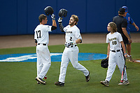 Johnny Aiello (2) of the Wake Forest Demon Deacons is greeted by teammate Bruce Steel (17) after hitting a home run against the Florida Gators in Game Two of the Gainesville Super Regional of the 2017 College World Series at Alfred McKethan Stadium at Perry Field on June 11, 2017 in Gainesville, Florida.  (Brian Westerholt/Four Seam Images)