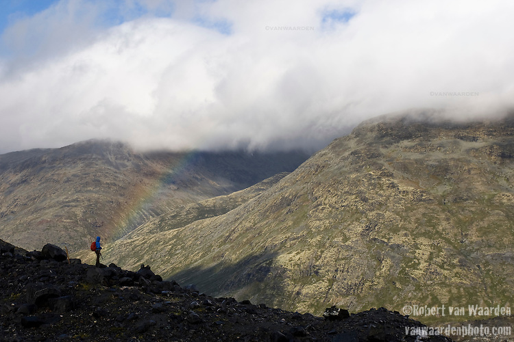 A rainbow lands on a member of the class hiking in the mountains of Norway.