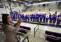 Katie Campbell, Spanish teacher and senior class sponsor at Elkins High School, takes a photograph Friday, May 14, 2021, of the school's senior class in the gymnasium prior to the start of commencement exercises at the school's football field. The school graduated 95 seniors. Visit nwaonline.com/210515Daily/ for today's photo gallery. <br /> (NWA Democrat-Gazette/Andy Shupe)