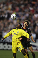 7 May 2005.  Columbus forward Edson Buddle (12) tries to shield the ball away from DC United's Brandon Prideaux (4) at RFK Stadium in Washington, DC.