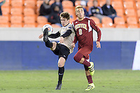 Houston, TX -  Friday, December 9, 2016:  Kevin Politz (4) of the Wake Forest Demon Deacons clears the ball in front of Andre Shinyashiki (9) of the Denver Pioneers at the  NCAA Men's Soccer Semifinals at BBVA Compass Stadium.
