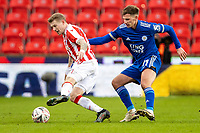 9th January 2021; Bet365 Stadium, Stoke, Staffordshire, England; English FA Cup Football, Carabao Cup, Stoke City versus Leicester City; James McClean of Stoke City cuts back under pressure from Marc Albrighton of Leicester City