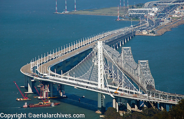 aerial photograph of the old and new eastern spans of the San Francisco Oakland Bay Bridge