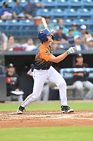 """Asheville Tourists C.J. Stubbs (15) swings at a pitch during a game against the Aberdeen IronBirds on June 20, 2021 at McCormick Field in Asheville, NC. Tourists players were wearing jerseys for the """"Yacumamas de Asheville"""", as part of Minor League Baseball's """"Copa de la Diversion"""". (Tony Farlow/Four Seam Images)"""