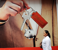 A woman walk passes a DBS advertisement in Hong Kong. DBS is one of the largest financial services groups in Asia, the largest bank in Singapore and the fifth largest banking group in Hong Kong as measured by asset..
