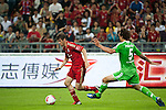 GUANGZHOU, GUANGDONG - JULY 26:  Thomas Muller (L) of Bayern Munich and Pogatetz of VfL Wolfsburg in action during a friendly match as part of the Audi Football Summit 2012 on July 26, 2012 at the Guangdong Olympic Sports Center in Guangzhou, China. Photo by Victor Fraile / The Power of Sport Images
