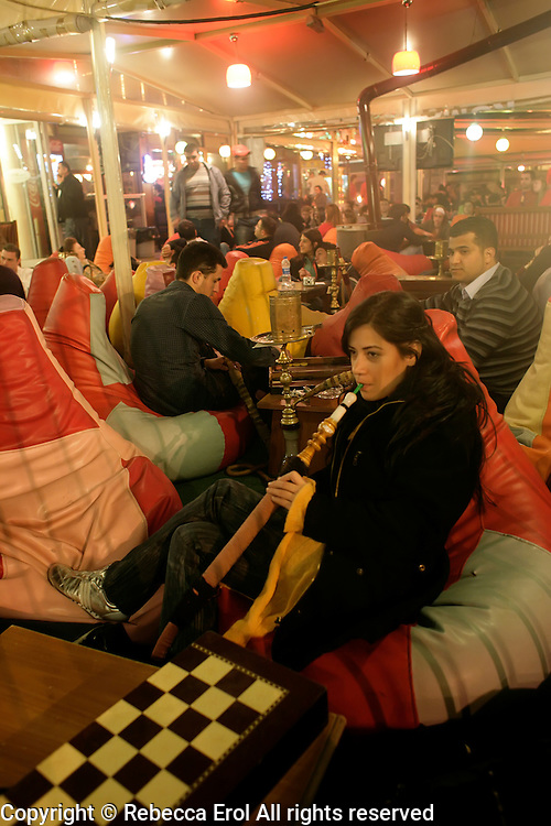 Smoking nargile (hookah) at one of the Tophane nargile cafes in Istanbul, Turkey