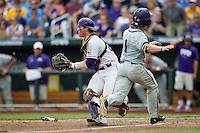 LSU Tigers catcher Kade Scivicque (22) waits for a throw as TCU Horned Frogs baserunner Cody Jones (1) scores in the NCAA College World Series on June 14, 2015 at TD Ameritrade Park in Omaha, Nebraska. TCU defeated LSU 10-3. (Andrew Woolley/Four Seam Images)