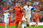 EURO 2016 QUALIFYING: WALES V ISRAEL AT CARDIFF CITY STADIUM : <br /> Gareth Bale of Wales is challenged for the ball by Orel Dgani of Israel.<br /> <br /> EDITORIAL USE ONLY.