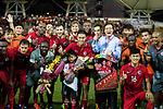 Chan Wai Ho of Hong Kong (L) poses for photos with his teammates after played the last match for Hong Kong during the International Friendly match between Hong Kong and Jordan at Mongkok Stadium on June 7, 2017 in Hong Kong, China. Photo by Cris Wong / Power Sport Images