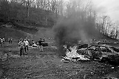 Machine Gun Shoot<br /> Knob Creek<br /> Westpoint, Kentucky<br /> USA<br /> April 5, 2009<br /> <br /> Nearly 16,000 people attend the Knob Creek Machine Gun Shoot & Military Gun Show. It is the largest gathering of Civilian owned machine guns in the world. The gun show has over 700 tables with machine guns, military surplus, ammo, hard to find parts & pieces and regular firearms and supplies.<br /> <br /> Firearms sales have surged in the six months since Obama's election as millions of Americans have gone on a buying spree that has stripped gun shops in some parts of the country almost bare of assault weapons and led to a national ammunition shortage.<br /> <br /> The FBI says that since November more than seven million people applied for criminal background checks in order to buy weapons, a figure excluding the many more buying at thousands of gun shows in states such as Virginia, without facing any checks.<br /> <br /> Gun-shop owners and the National Rifle Association say the surge is driven by worries that Obama is planning to ban many types of firearms and that the deepening economic crisis will fuel a crime wave, as witnessed by the string of mass shootings in the past few weeks.<br /> <br /> But control groups pressing for greater control on firearms accuse the NRA of funding a massive scare campaign to portray Obama as a gun owner's worst nightmare and to argue that tighter restrictions on weapons ownership are a threat to broader liberties and a step toward tyranny.