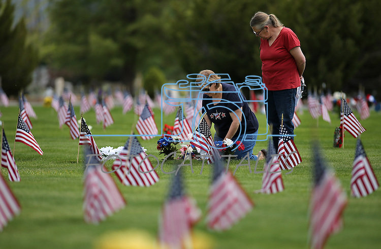 Margy Schieberl, left, and Penny Kiechler, both of Virginia City, visit the graves of family members in the veterans section of Lone Mountain Cemetery in Carson City, Nev., on Monday, May 25, 2015. <br /> Photo by Cathleen Allison