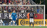 Foxborough, Massachusetts - June 30, 2018: In a Major League Soccer (MLS) match, New England Revolution (blue/white) defeated D.C. United (white/gray/red), 3-2, at Gillette Stadium.<br /> Penalty kick.