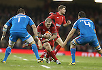 Wales prop Paul James takes on Italian pair Michele Rizzo and Quintin Geldenhuys.<br /> RBS 6 Nations 2014<br /> Wales v Italy<br /> Millennium Stadium<br /> 01.02.14<br /> <br /> ©Steve Pope-SPORTINGWALES