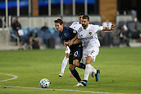 SAN JOSE, CA - OCTOBER 03: Carlos Fierro #21 of the San Jose Earthquakes is marked by Perry Kitchen #2 of the Los Angeles Galaxy during a game between Los Angeles Galaxy and San Jose Earthquakes at Earthquakes Stadium on October 03, 2020 in San Jose, California.