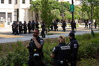 Police prepare for a shift change as demonstrators gather in support of Black Lives Matter near the White House in Washington D.C., U.S., on Tuesday, June 23, 2020.  Trump tweeted that he authorized the Federal government to arrest any demonstrator caught vandalizing U.S. monuments, with a punishment of up to 10 years in prison.  Credit: Stefani Reynolds / CNP/AdMedia