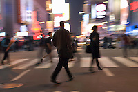 AVAILABLE FROM GETTY IMAGES FOR COMMERCIAL AND EDITORIAL LICENSING.   Please go to www.gettyimages.com and search for image # 135307806.<br /> <br /> Busy, Blurred Motion Scene of Commuters Crossing Street and Heading Home After Work During the Evening Rush Hour, Times Square and 42nd Street, Midtown Manhattan, New York City, New York State, USA